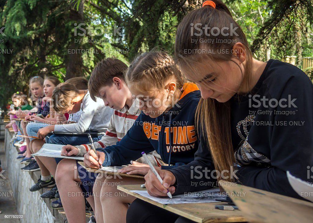 Children - school students draw sketches stock photo