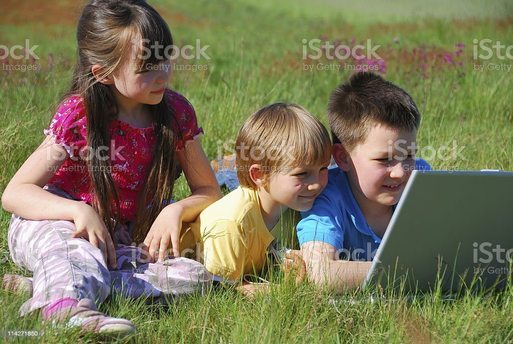 Children sharing laptop royalty-free stock photo