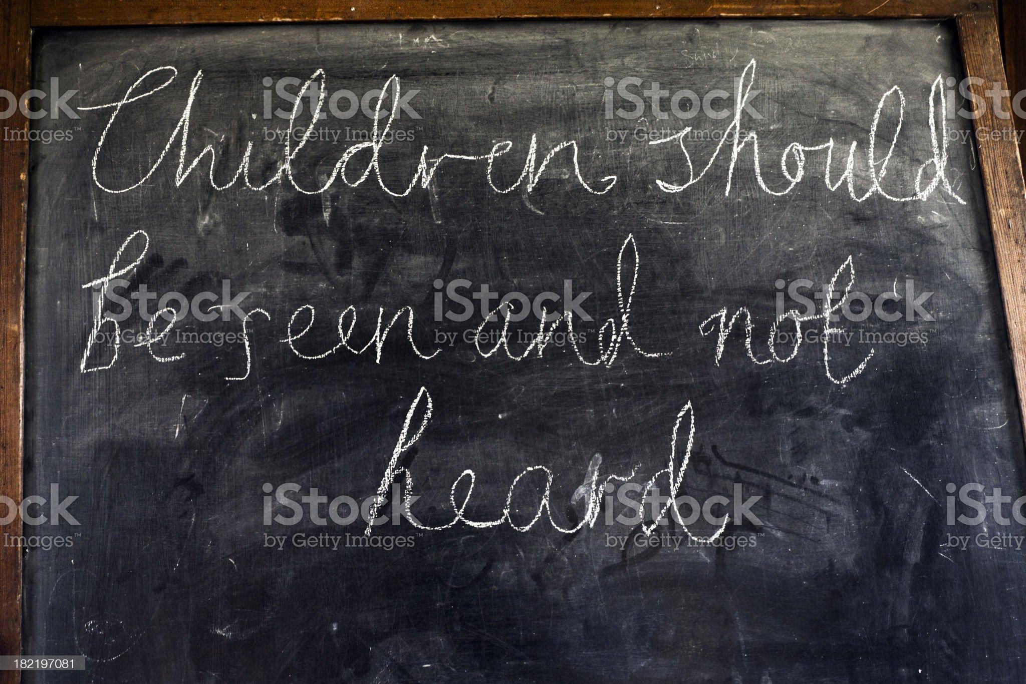 Children should be seen and not heard (blackboard inscription) royalty-free stock photo