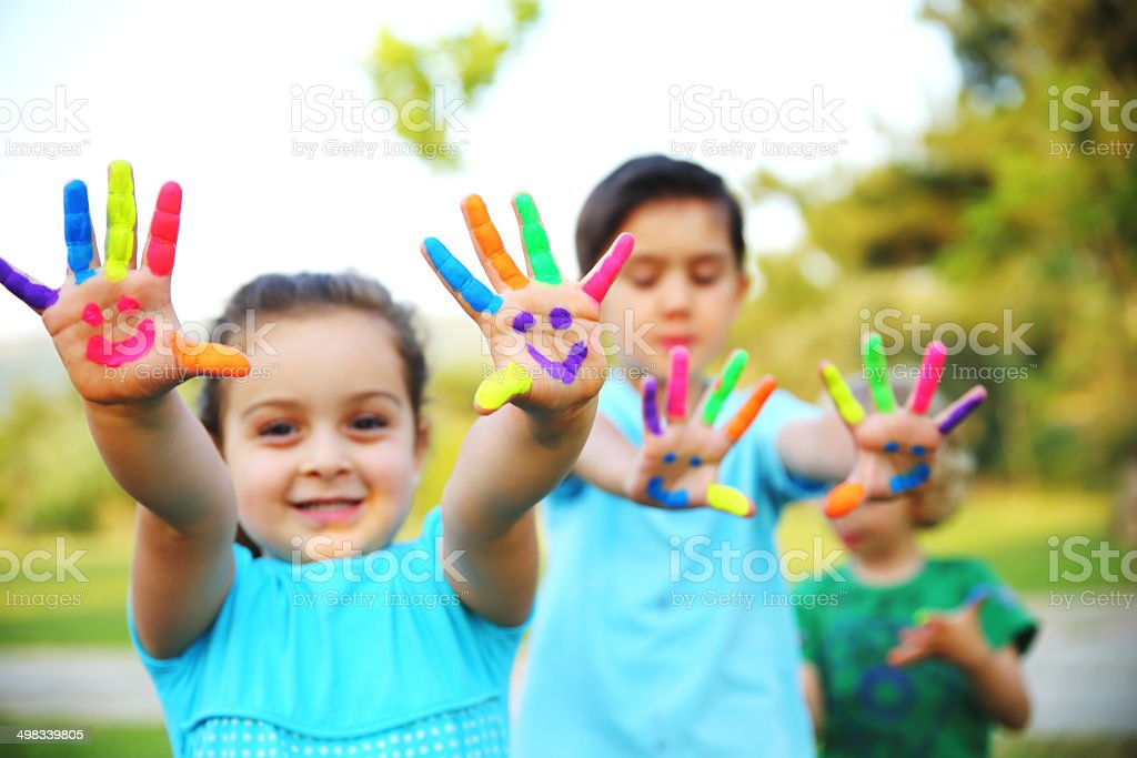 Children Showing Their Painted Hands stock photo