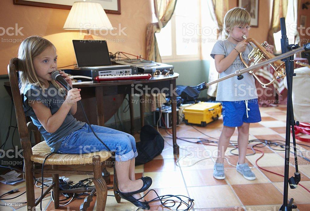 Children singing and playing music stock photo