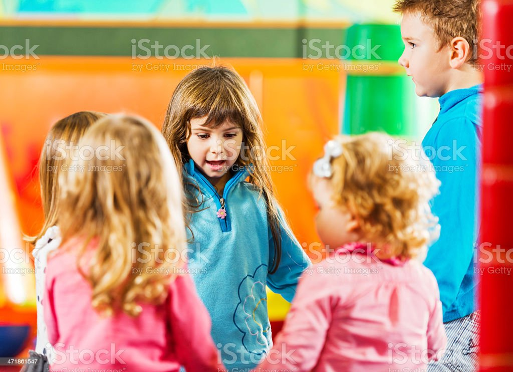Children singing in a circle. stock photo