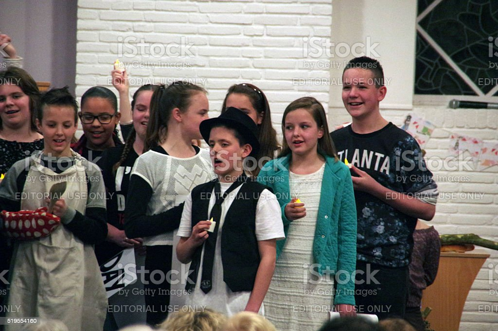 Children singing in Church stock photo
