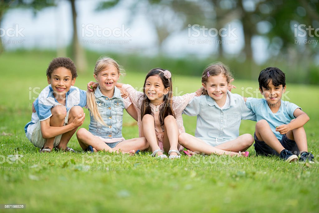 Children Sitting in the Park stock photo