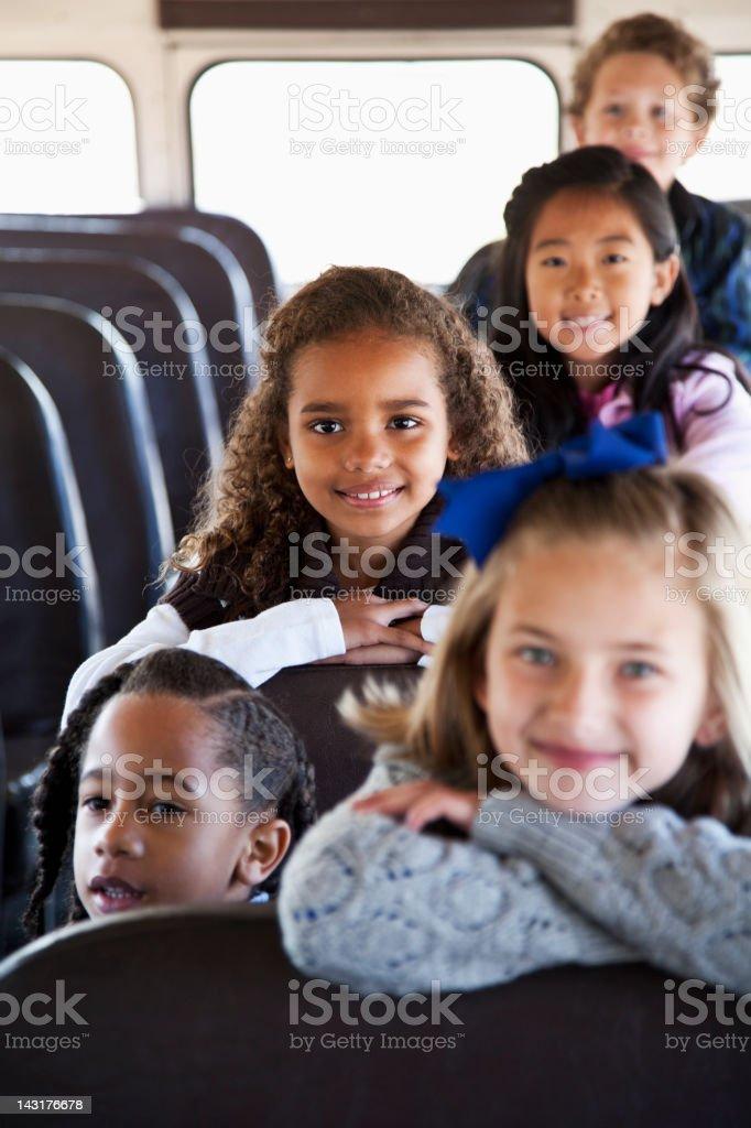 Children sitting inside school bus stock photo