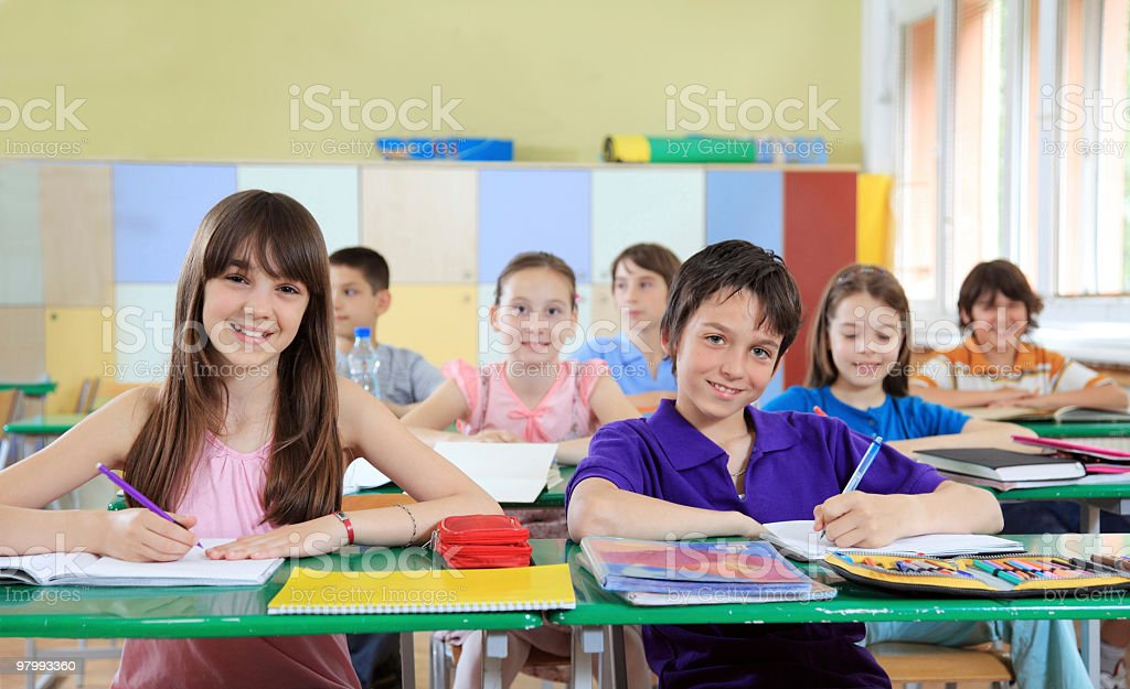 Children sitting on a lesson. stock photo
