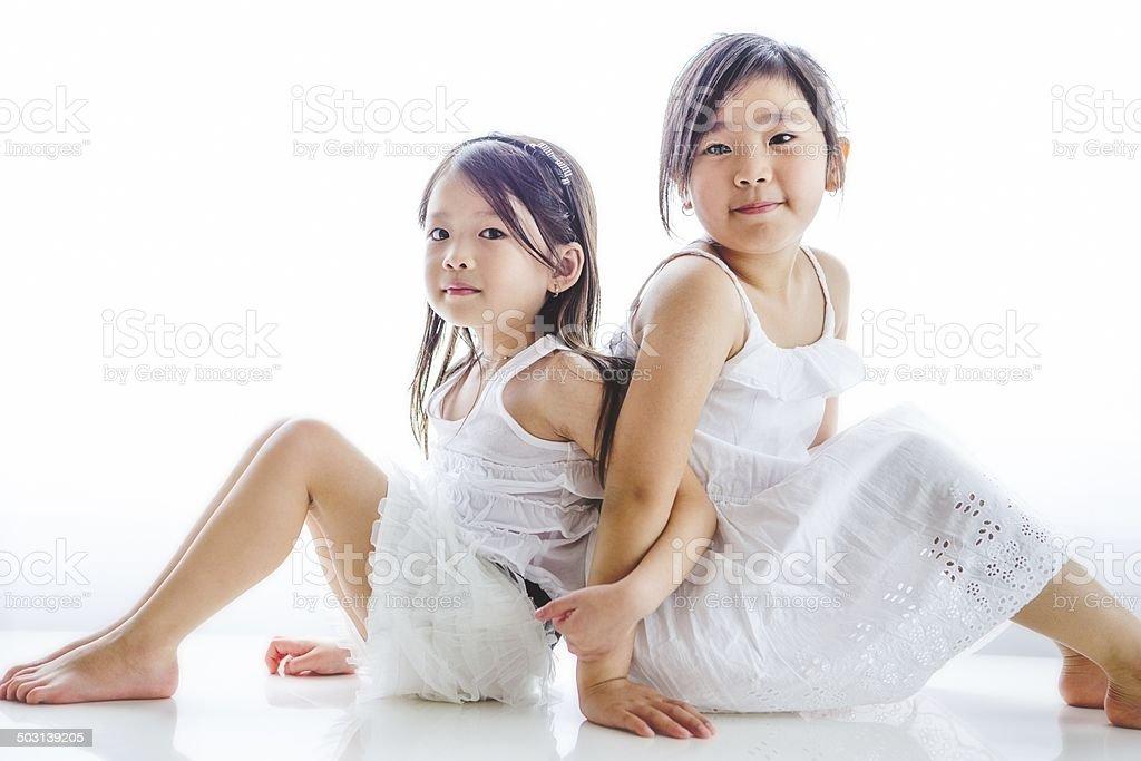 Children sitting on floor. royalty-free stock photo