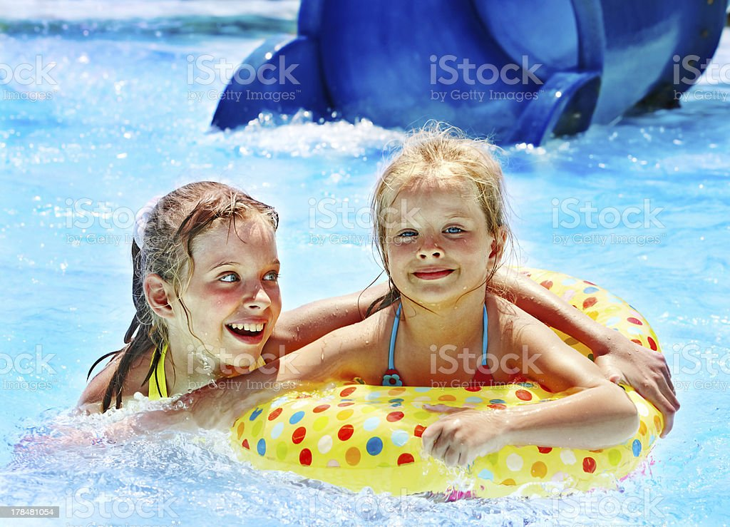 Children sitting on inflatable ring. royalty-free stock photo
