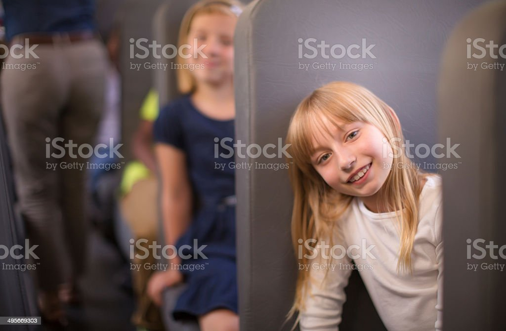 children sitting on school bus stock photo
