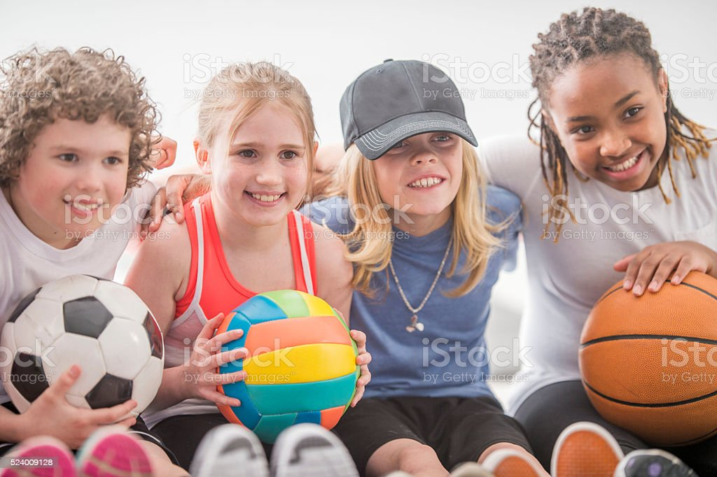 Children Sitting Together During PE stock photo