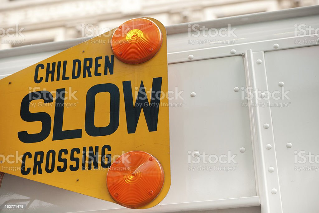 Children slow crossing sign detail stock photo