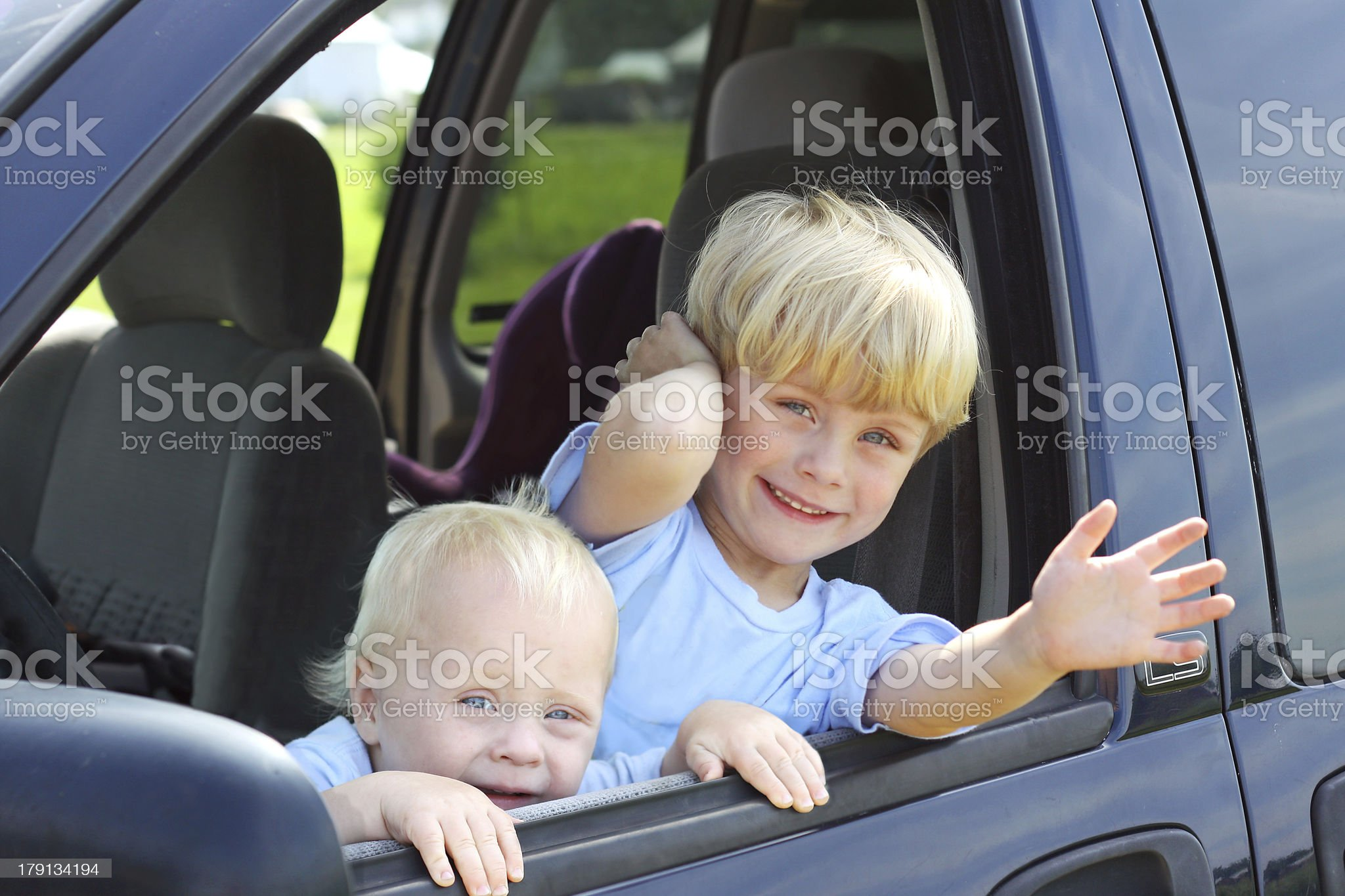 Children Smiling Out Van Window royalty-free stock photo