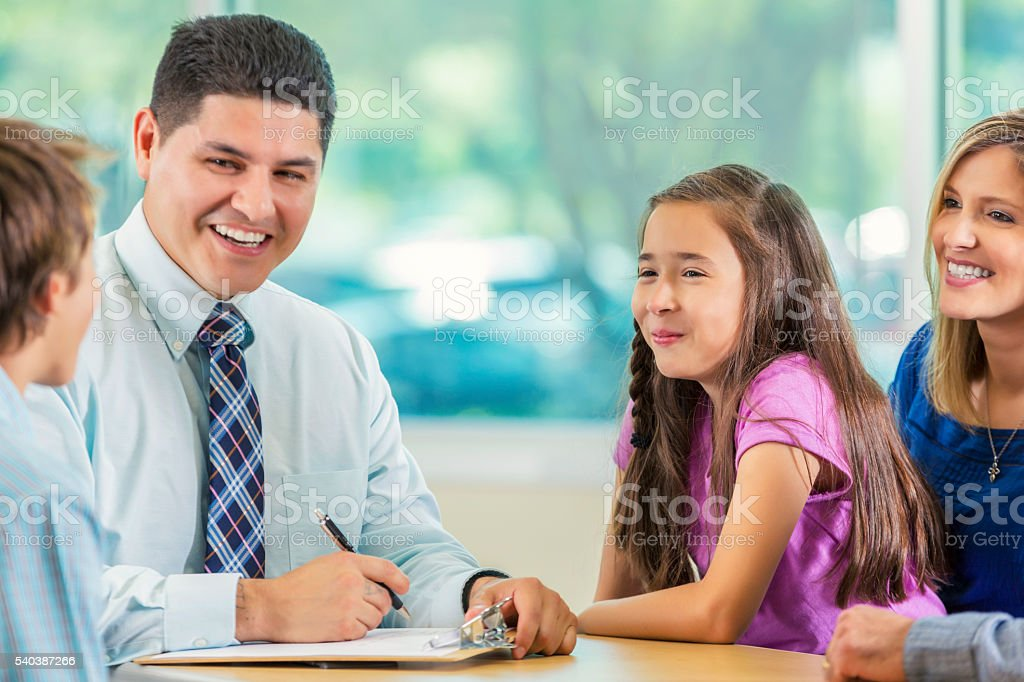 Children speak to businessman stock photo