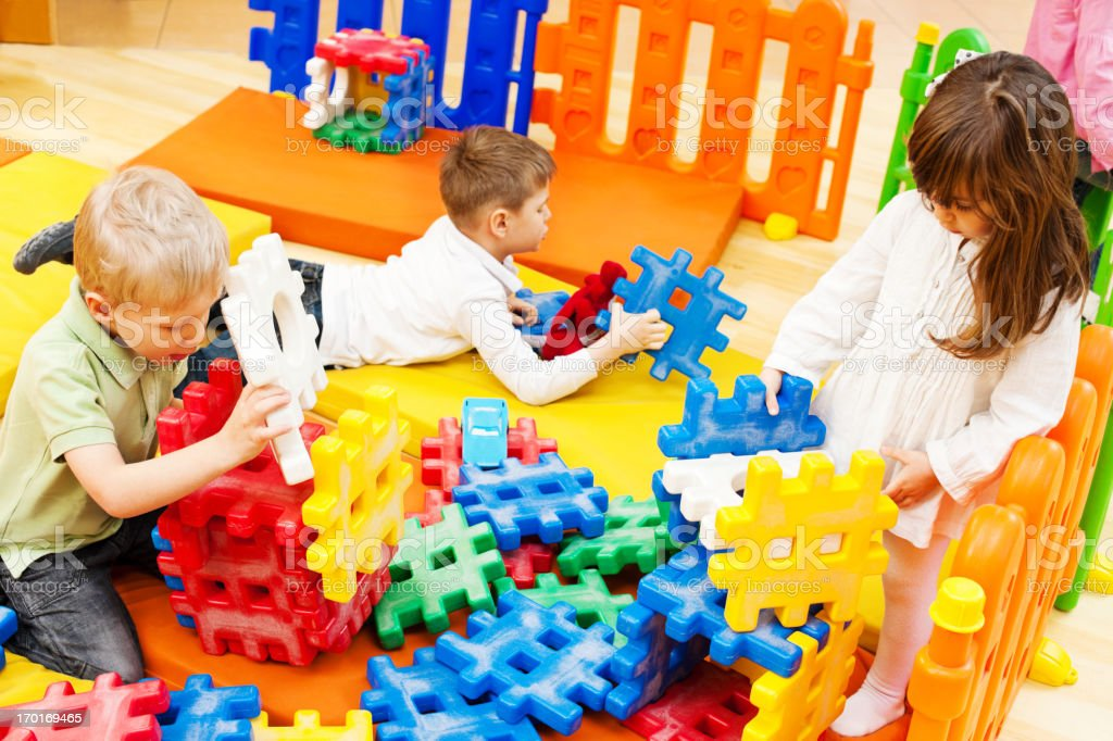 Children stacking blocks. royalty-free stock photo