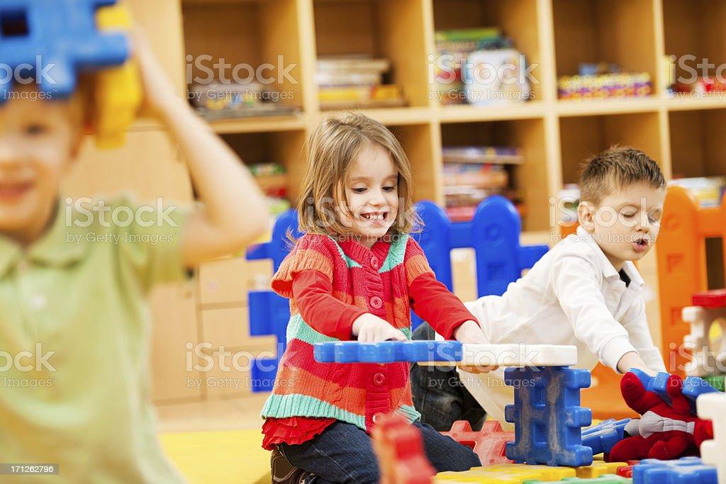 Children stacking blocks. royalty-free stock photo
