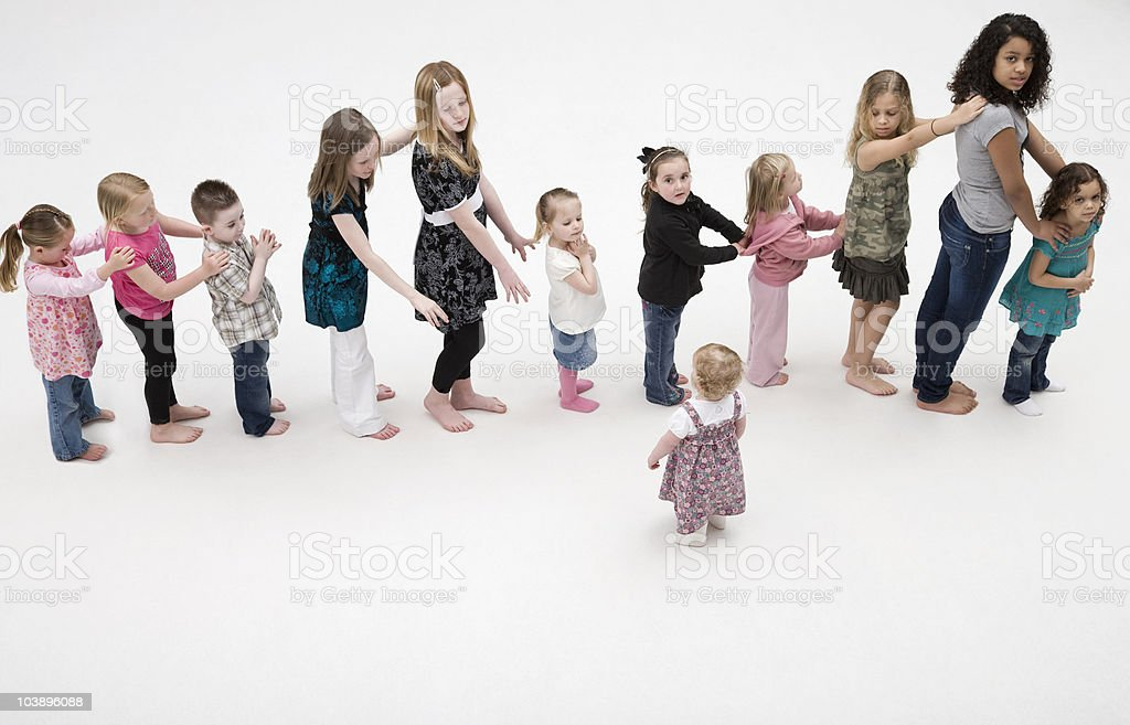 Children standing in a line. stock photo