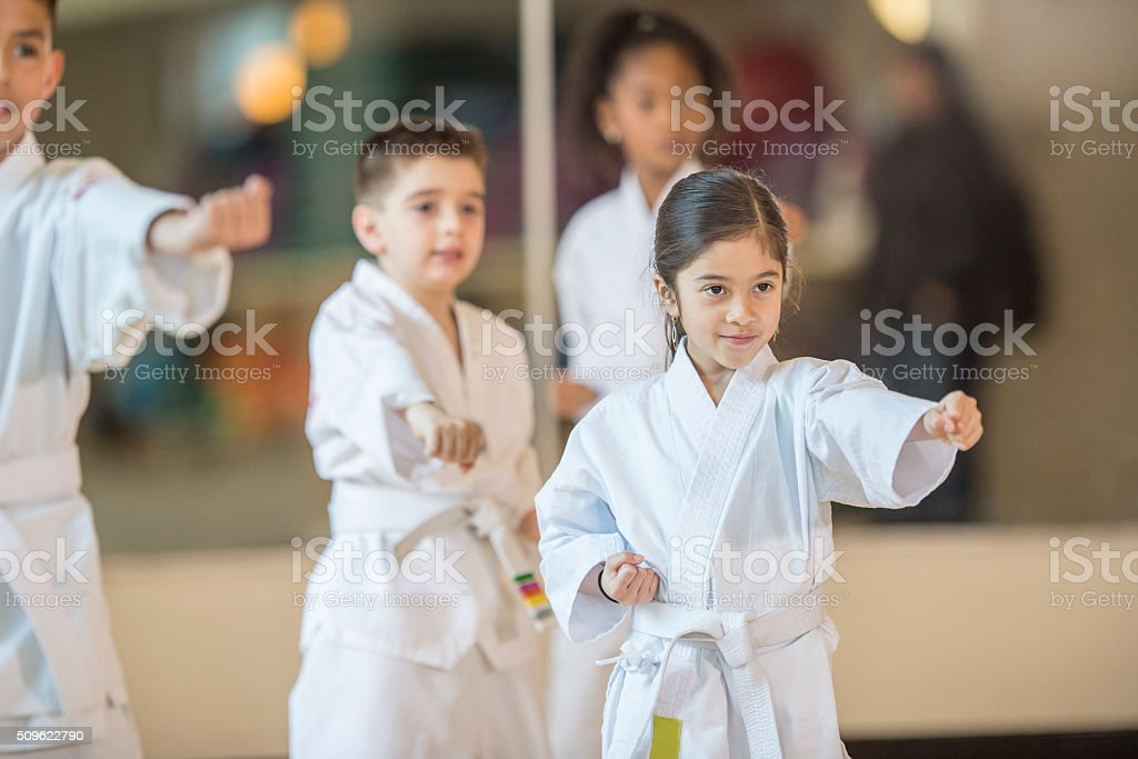 Children Standing in Formation stock photo