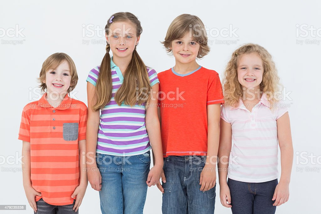Children standing on white background stock photo