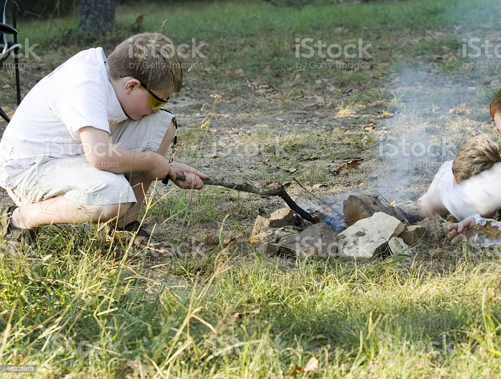 Children Starting Campfire. stock photo