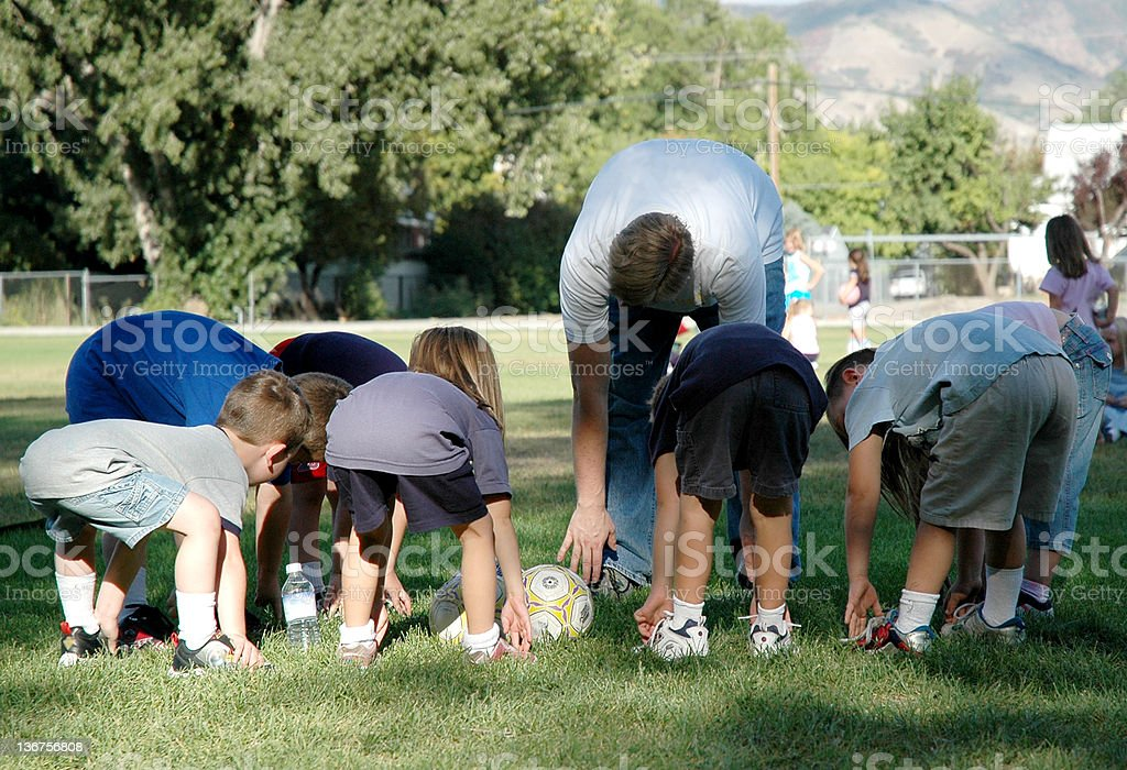 Children Stretching at Soccer Practice stock photo