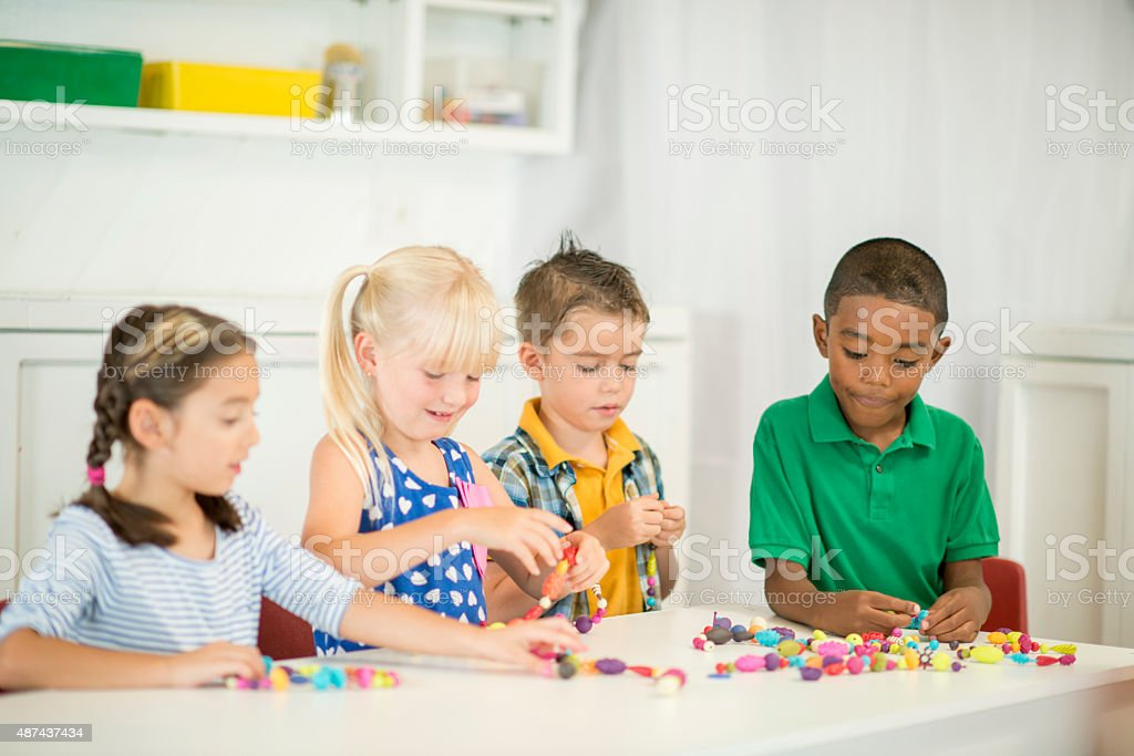 Children Stringing Beads stock photo