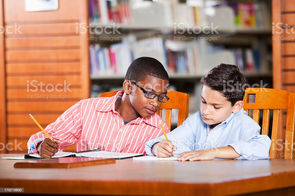 Children studying in library royalty-free stock photo