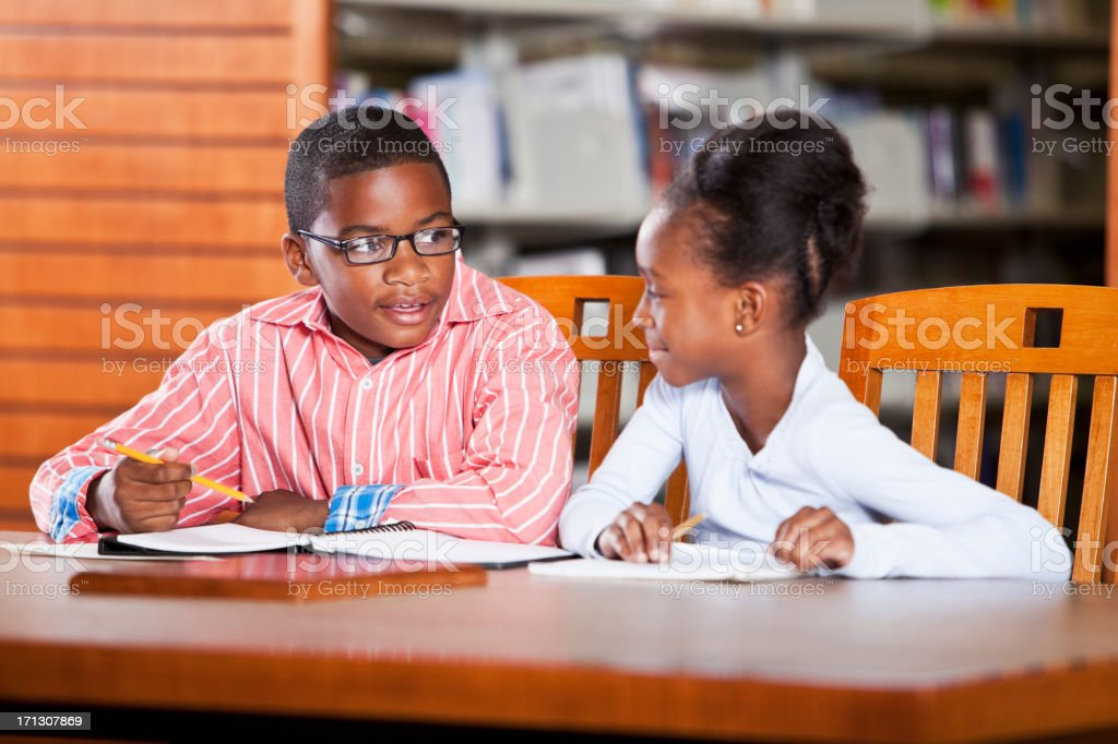 Children studying in library stock photo