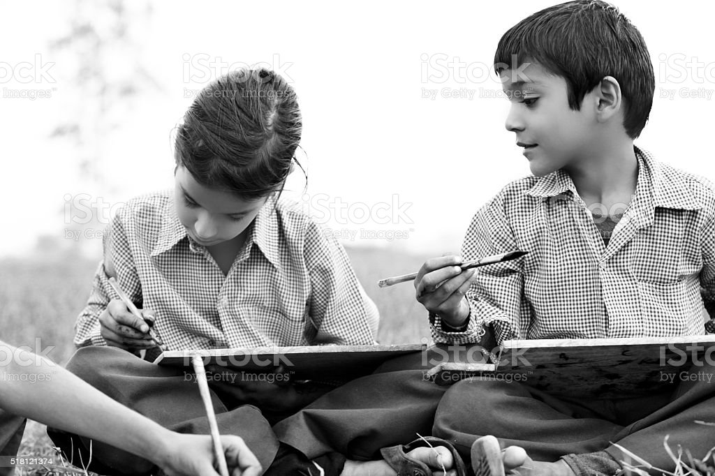 Children studying & writing concept in the Nature stock photo