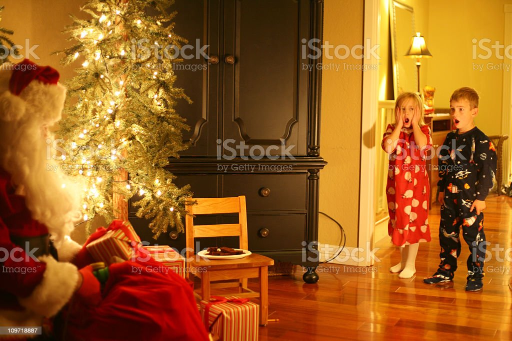 Children Surprised That Santa Is Sitting In The House royalty-free stock photo