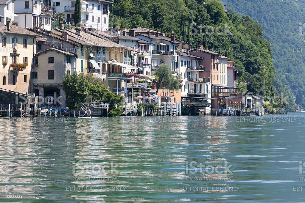 Children swimming in Lake Lugano royalty-free stock photo