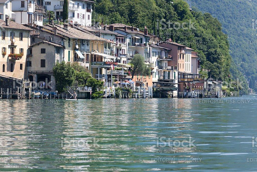 Children swimming in Lake Lugano stock photo
