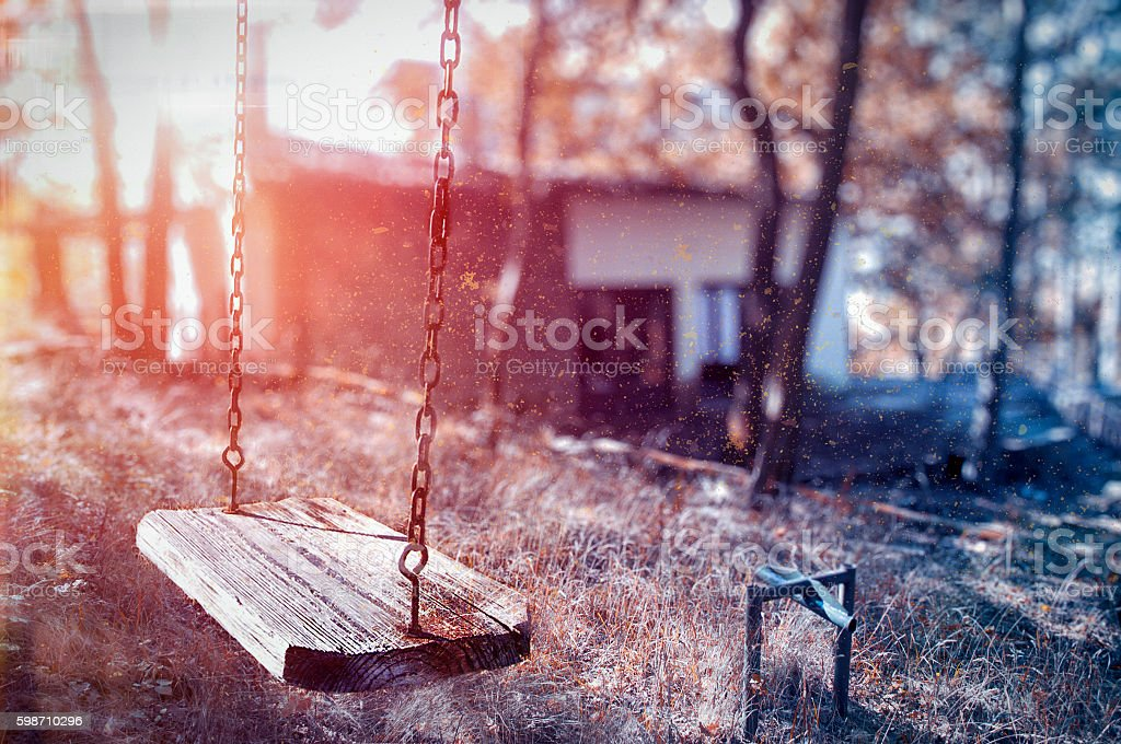 Children swing in the park stock photo
