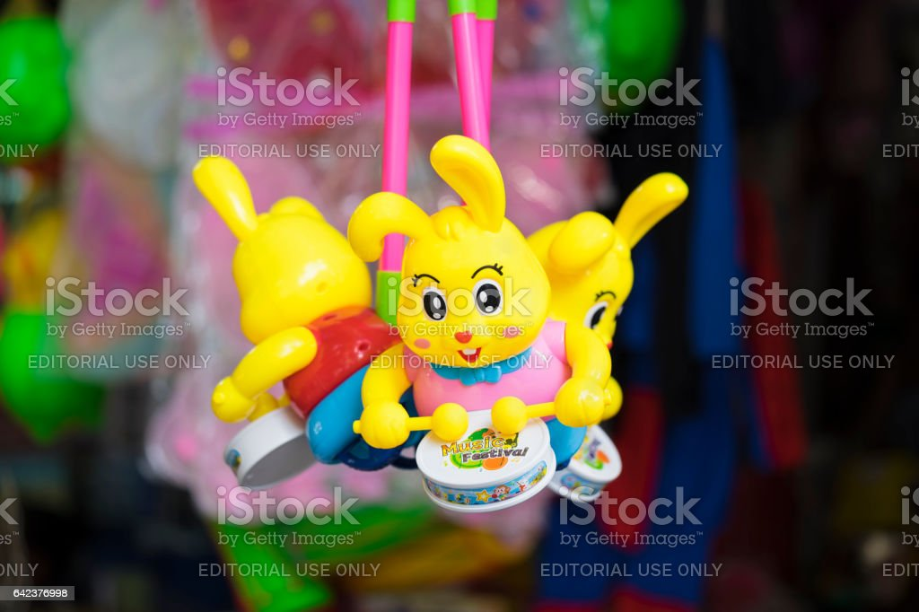 Hanoi, Vietnam - Sep 7, 2015: Children toys for sale on Hang Ma street. The street are crowded and busy before Vietnamese Mid-Autumn Festival for children who receive toys, fruit and moon cake as gift stock photo
