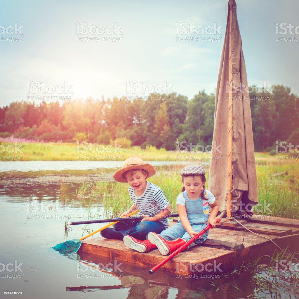Children traveling on raft stock photo