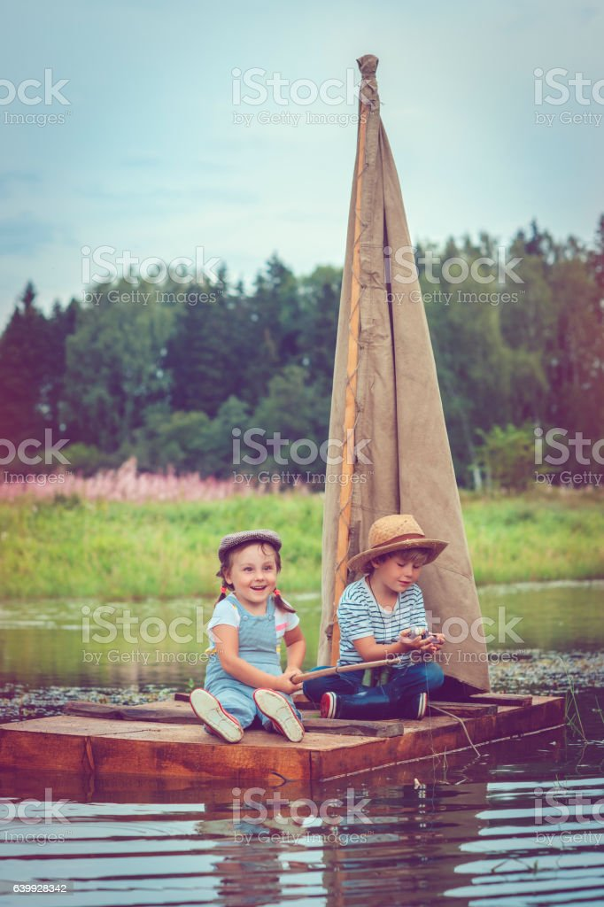 Children traveling on raft stock photo