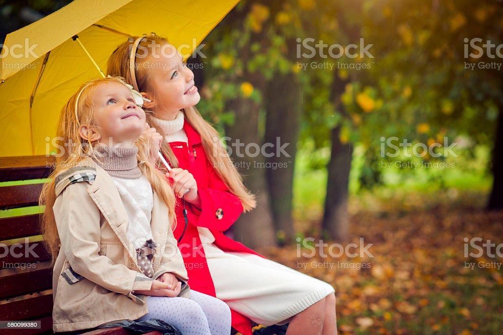 Children under umbrella stock photo