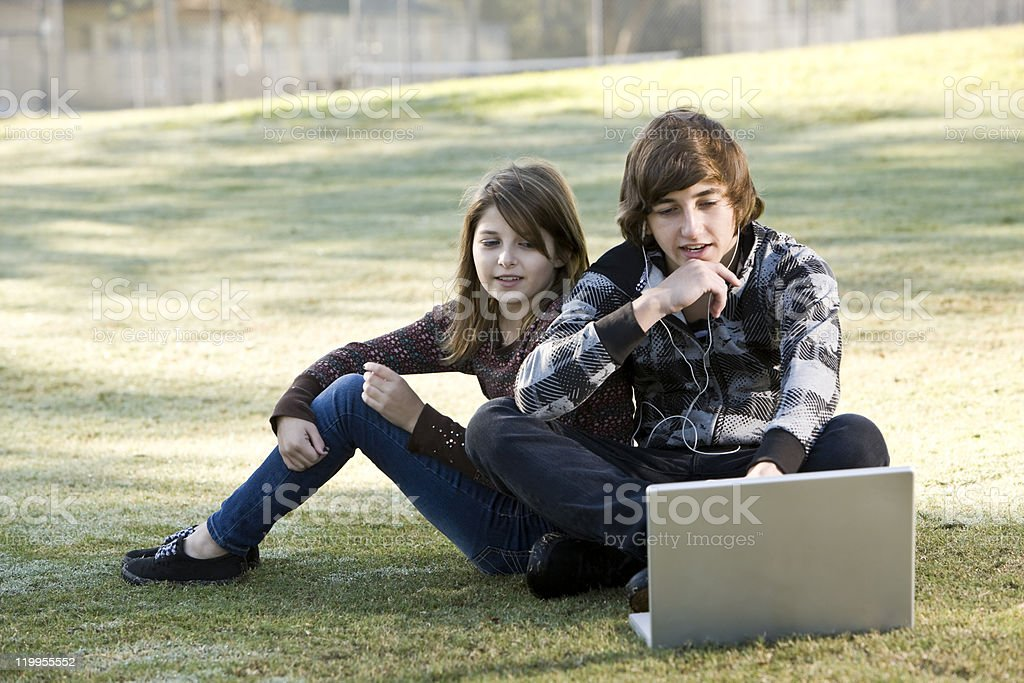 Children using laptop in park royalty-free stock photo