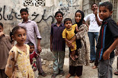 Children wait for Street School in Lyari to start