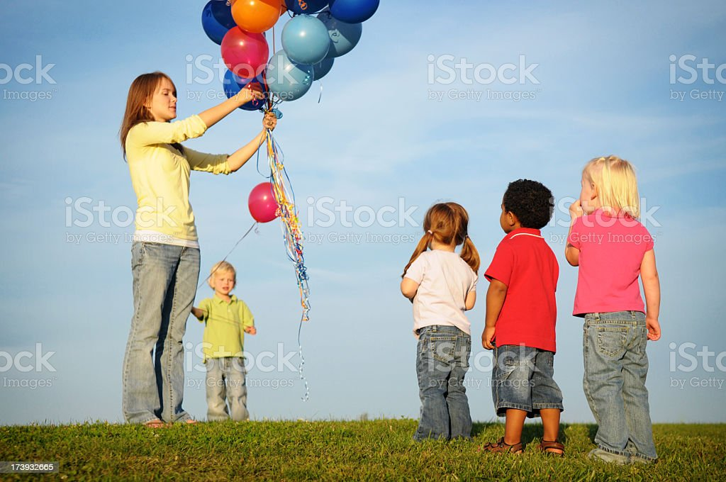 Children Waiting in Line for a Balloon royalty-free stock photo