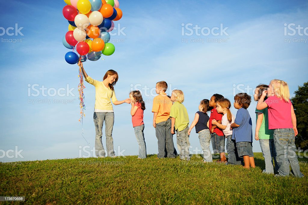 Children Waiting in Line for Balloons royalty-free stock photo