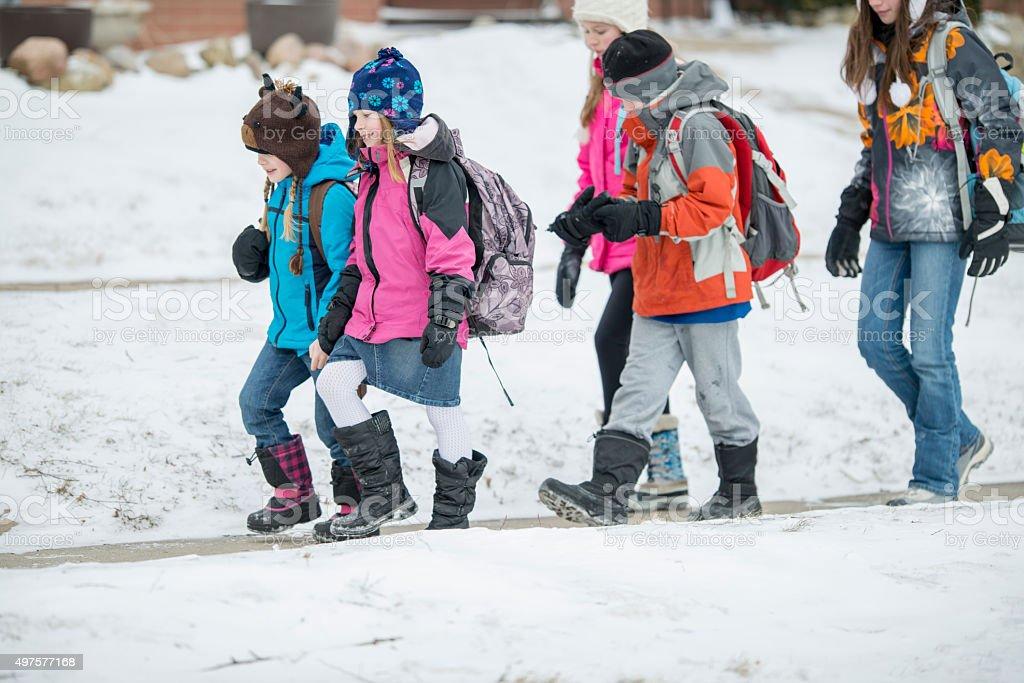 Children Walking Outside in Winter stock photo