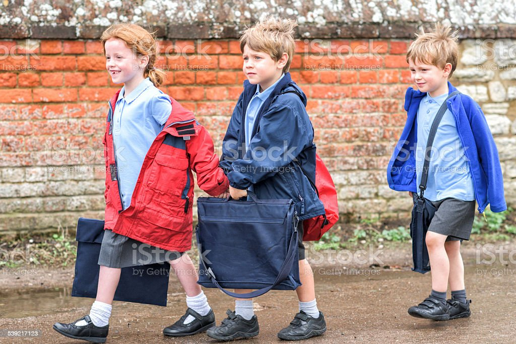 Children walking to UK primary school stock photo
