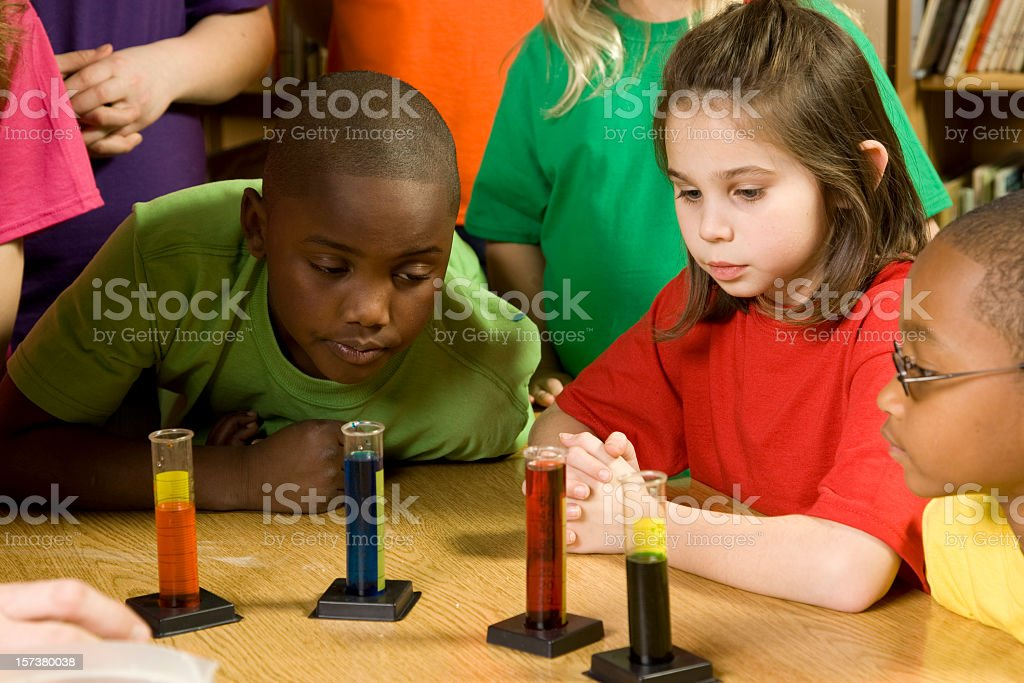 Children watching a colorful liquids science demonstration royalty-free stock photo