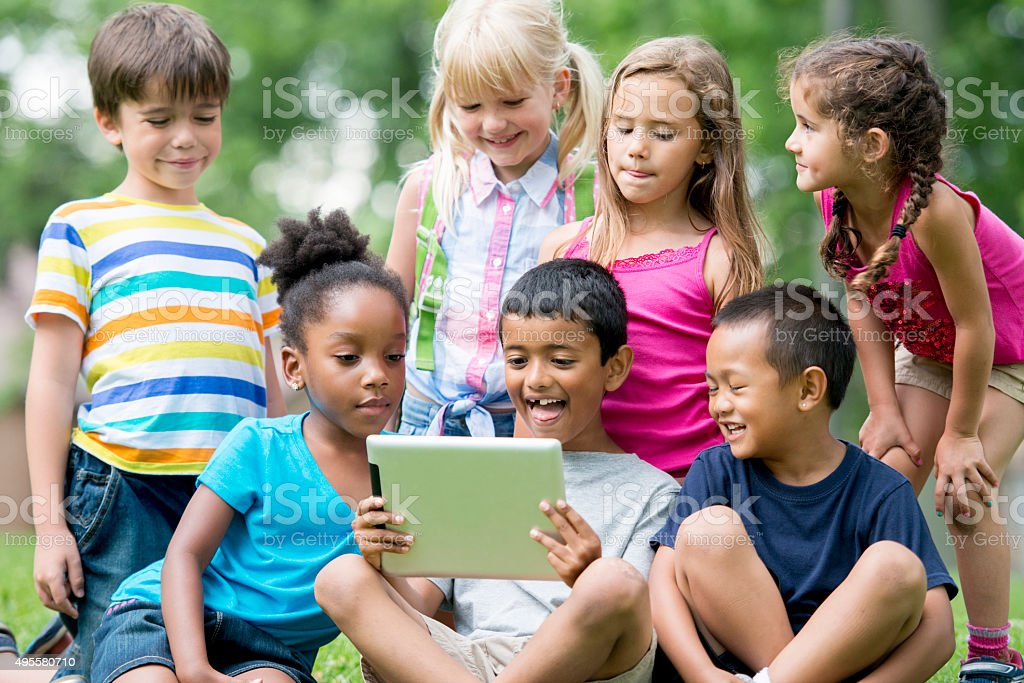 Children Watching a Video in the Park stock photo