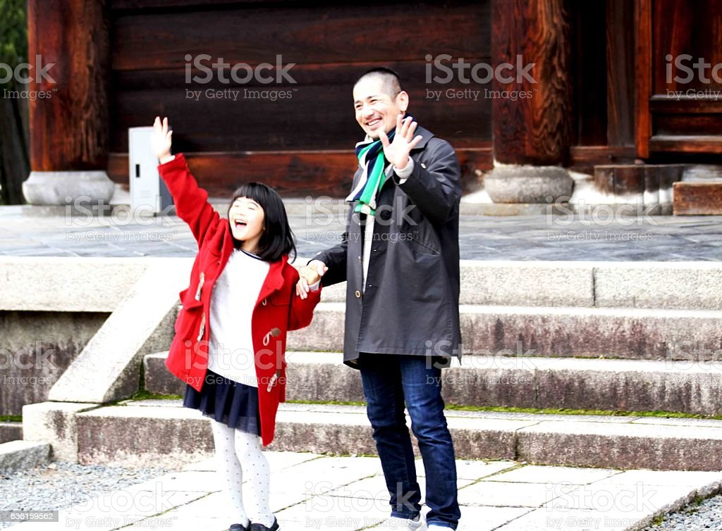 Children waving the father happily Tofukuji stock photo
