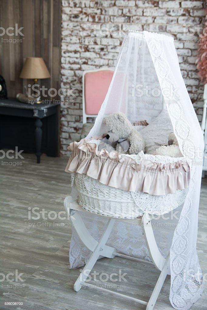 Children wicker cradle with teddy bears stock photo