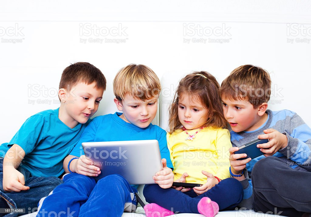 Children with a digital tablet royalty-free stock photo