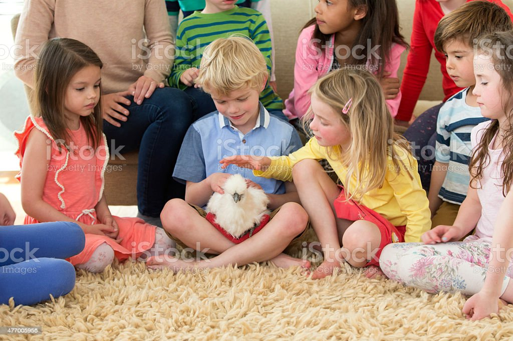 Children With A Pet Chicken stock photo