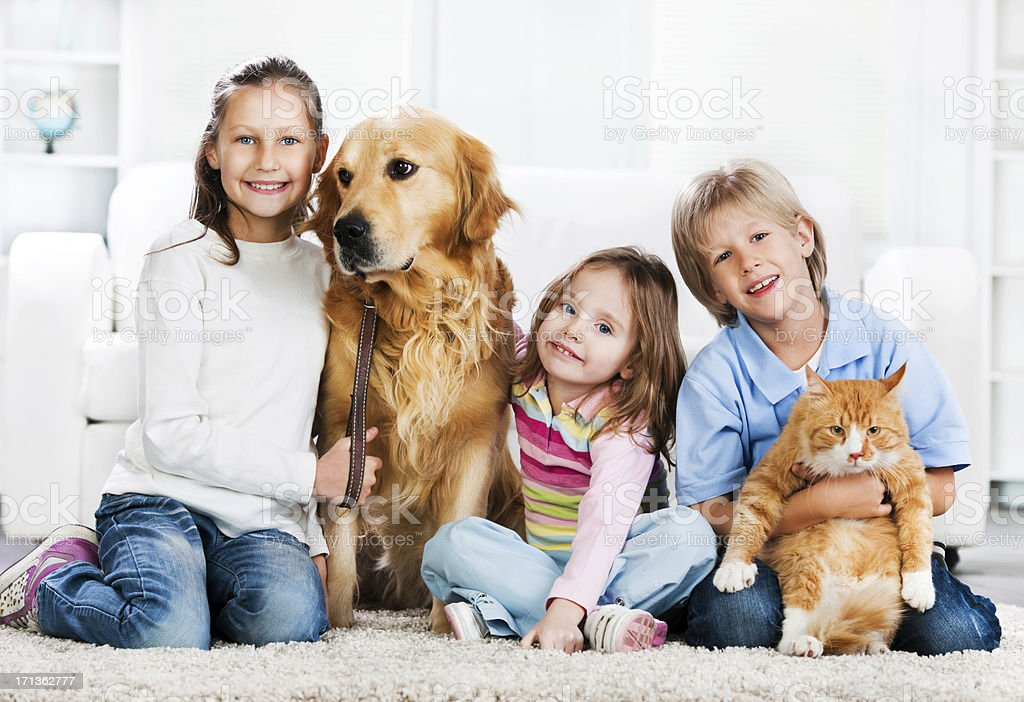 Children with animals sitting on the carpet. royalty-free stock photo