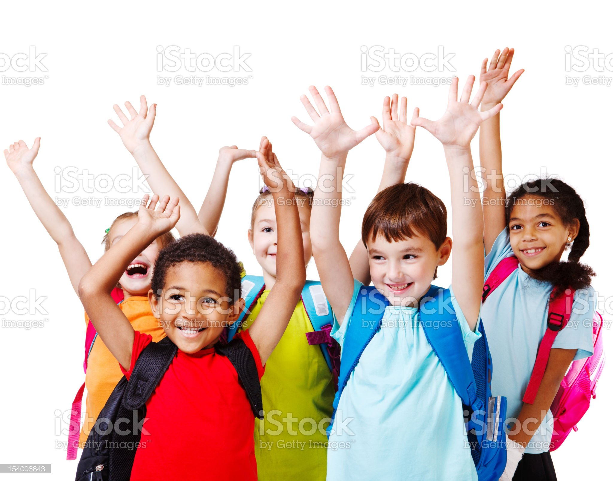 Children with backpacks holding their hands in the air royalty-free stock photo